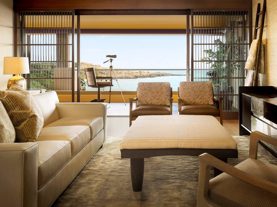 alii-features-a-formal-living-room-with-adjoining-powder-room-and-the-deck-includes-binocular-tripods-for-observing-the-bay-where-spinner-dolphins-are-known-to-play