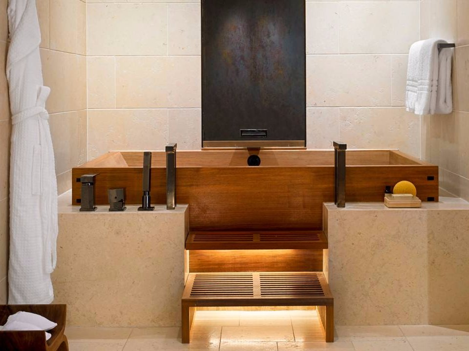 in-the-main-bathroom-a-double-japanese-soaking-tub-a-double-walk-in-steam-shower-with-seating-dual-vanities-and-a-vanity-mirror-television